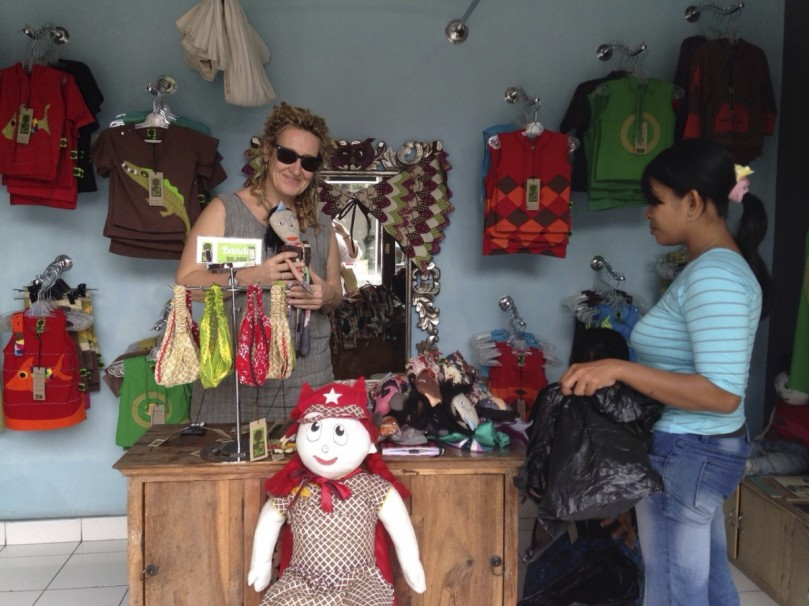 Finding Local Handicrafts, in this case some handmade animal dolls made from recycled materials by a fair trade womens initiate in the local village.